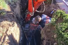 Anbohrung eines Kanals  - Mit einem speziellen Bohrgerät wird eine Öffnung in das bestehende Kanalrohr gebohrt.